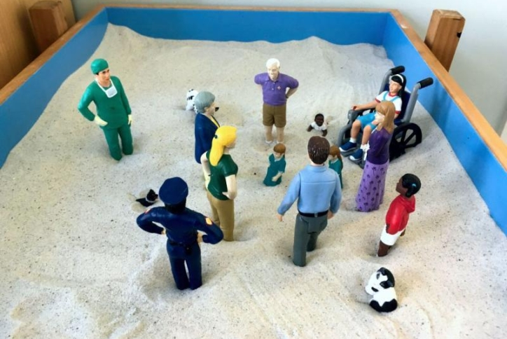 Toy figurines on a sand pit