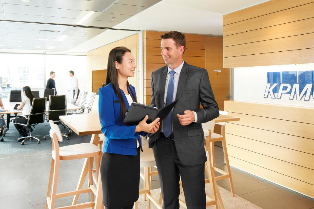 male and female businesspeople in modern office