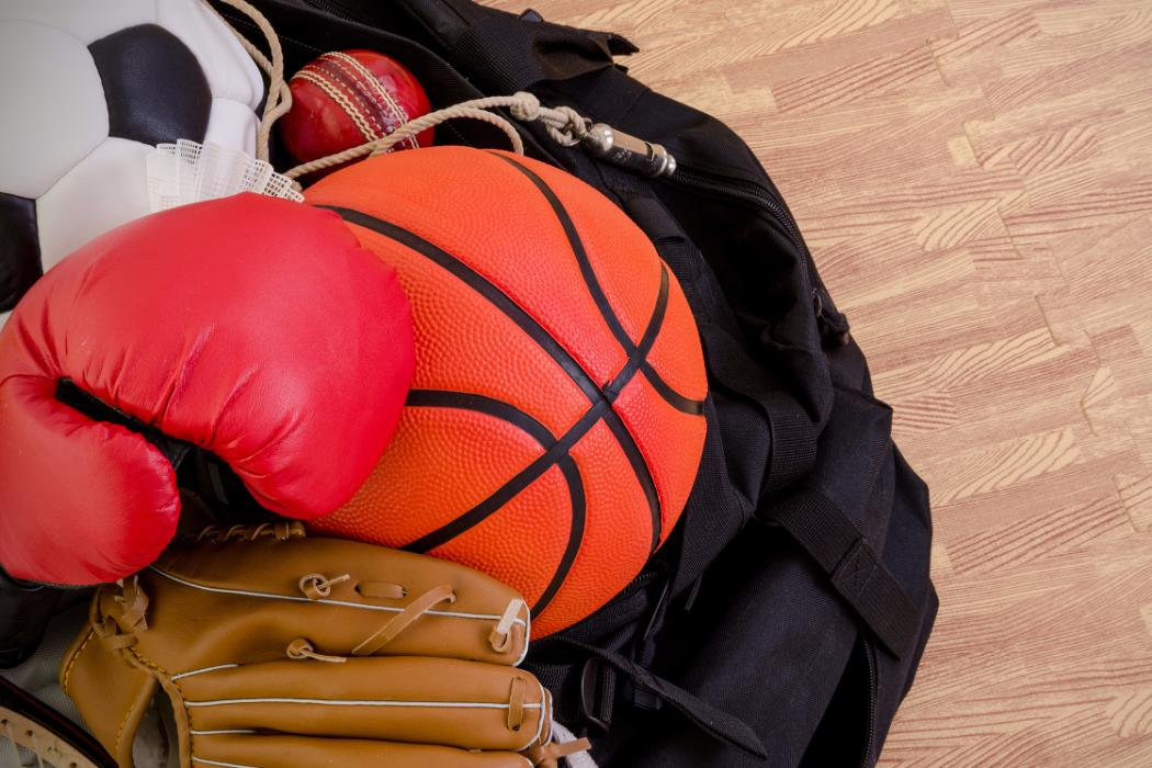 variety of sports equipment on gym floor