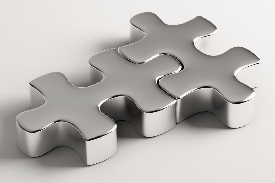 puzzle pieces fitting together to indicate partnership