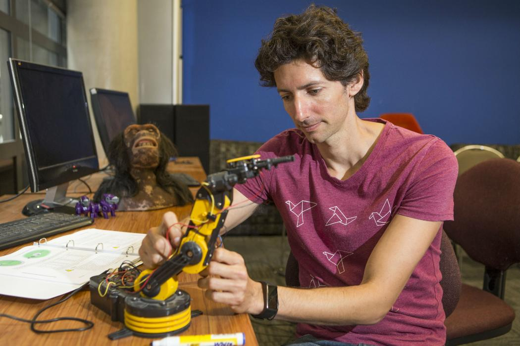 phd student with robot arm