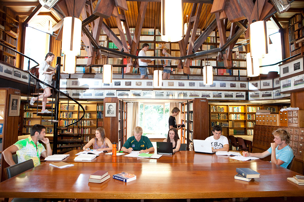 College house hall library students studying large table landscape